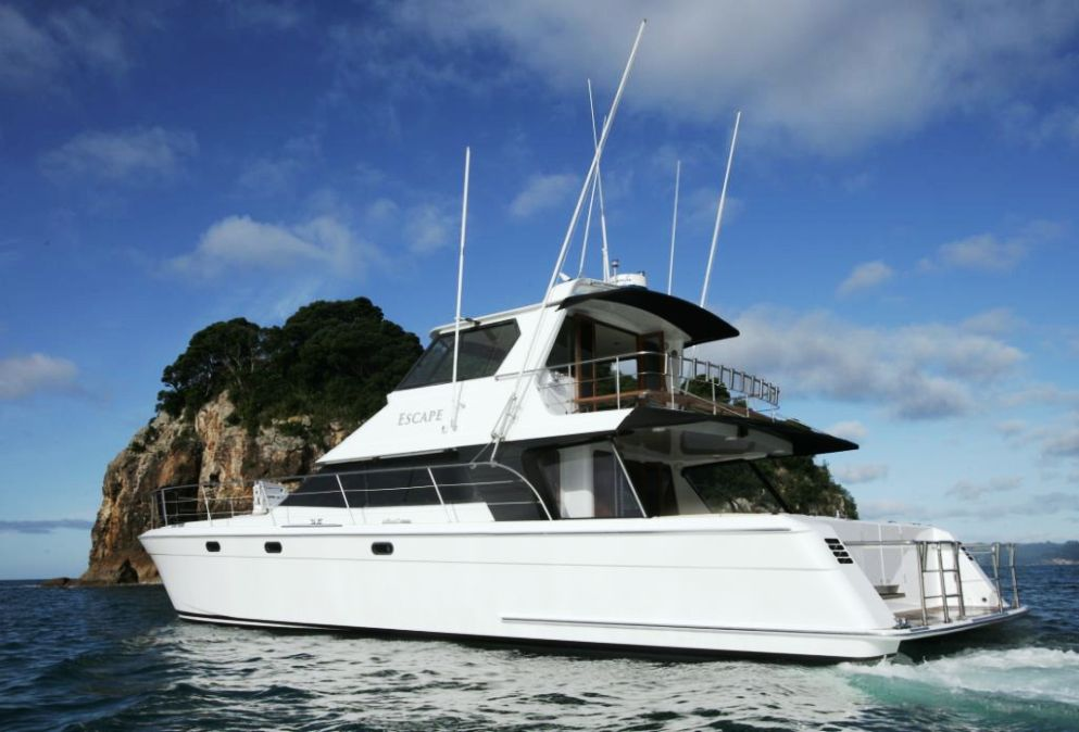 Escape charter boat auckland 55ft luxury catamaran for Fishing charters auckland